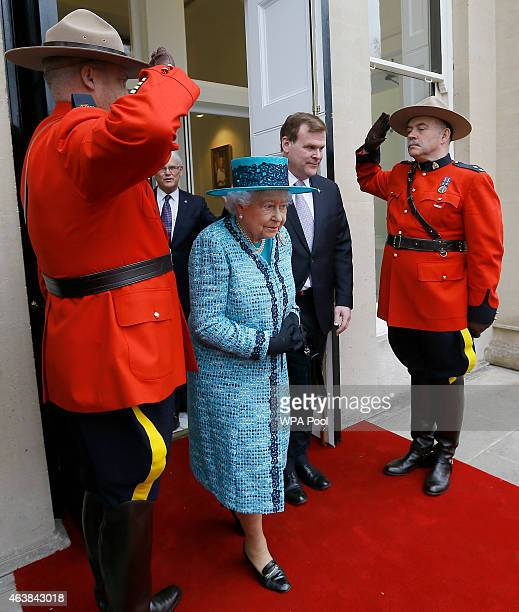 Queen Elizabeth II accompanied by Former Canadian Minister of Foreign Affairs John Baird during a visit to reopen Canada House on Trafalgar Square...