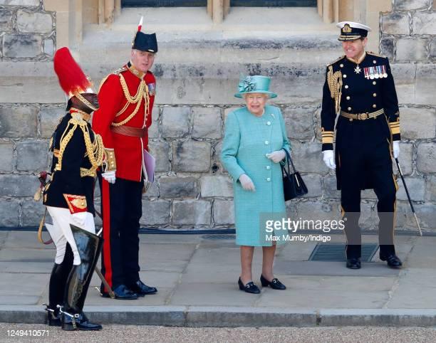 Queen Elizabeth II, accompanied by her equerry Lieutenant Colonel Nana Kofi Twumasi-Ankrah , Lieutenant Colonel Michael Vernon and Vice Admiral Tony...