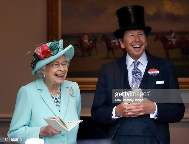 Queen Elizabeth II accompanied by her racing manager John Warren, attends day 5 of Royal Ascot at Ascot Racecourse on June 19, 2021 in Ascot, England.
