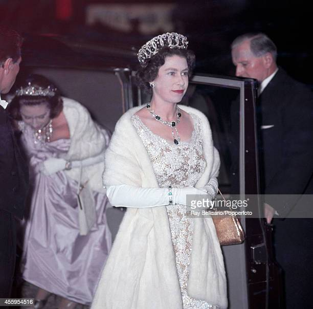 Queen Elizabeth II accompanied by her sister Princess Margaret attends the premiere of 'West Side Story' at the Odeon Cinema in Leicester Square...