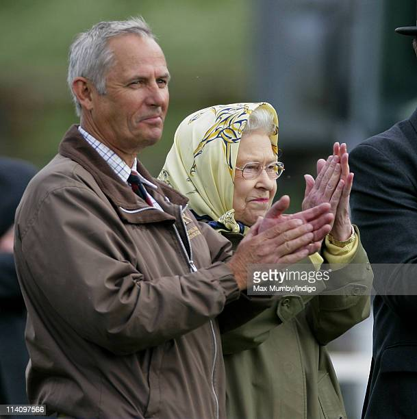 Queen Elizabeth II accompanied by her stud groom Terry Pendry applauds as her horse 'St James' wins the 'Veteran VeteranPlus Ridden' class at the...