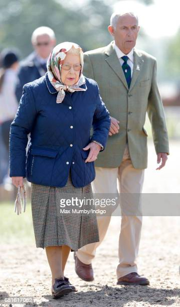 Queen Elizabeth II accompanied by her stud groom Terry Pendry attends day 1 of the Royal Windsor Horse Show in Home Park on May 10 2017 in Windsor...