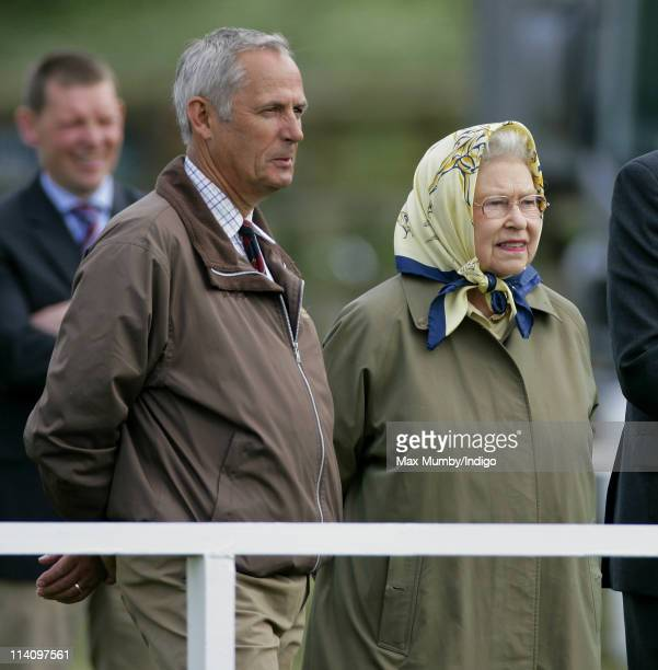 Queen Elizabeth II accompanied by her stud groom Terry Pendry watches her horse 'St James' compete in the 'Veteran VeteranPlus Ridden' class at the...