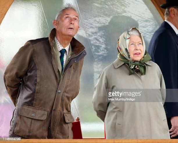 Queen Elizabeth II accompanied by her Stud Groom Terry Pendry watches her horse 'Balmoral Mandarin' compete in the BSPS Ridden Mountain and Moorland...