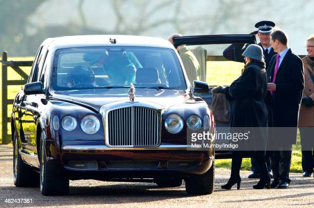 Queen Elizabeth II accompanied by Lady Helen Stewart gets into her Bentley car as she leaves St Mary Magdalene Church Sandringham after attending...