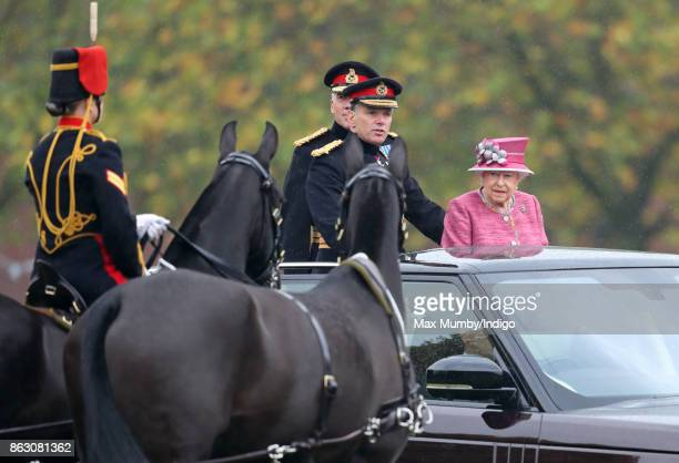 Queen Elizabeth II accompanied by Lieutenant General Sir Andrew Gregory stands in her State Review Range Rover to inspect troops of the King's Troop...