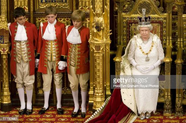 Queen Elizabeth II accompanied by Pages of Honour at the House of Lords Westminster for the State Opening of Parliament on November 6 2007 in London...