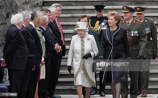 Queen Elizabeth II accompanied by President Mary McAleese for a wreath laying ceremony at the Garden of Remembrance on May 17 2011 in Dublin Ireland...