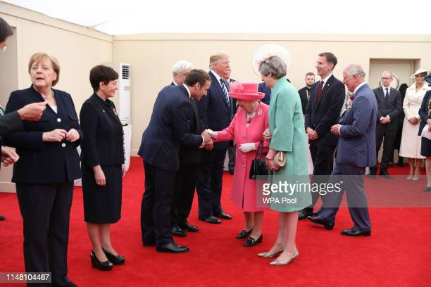 Queen Elizabeth II accompanied by Prime Minister Theresa May Foreign Secretary Jeremy Hunt and Prince Charles Prince of Wales meet French President...