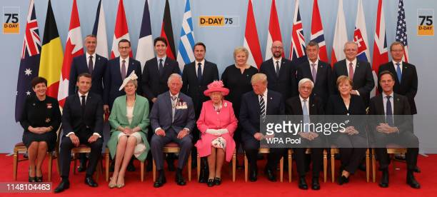 Queen Elizabeth II accompanied by Prime Minister Theresa May Prince Charles Prince of Wales President of the United States Donald Trump and First...