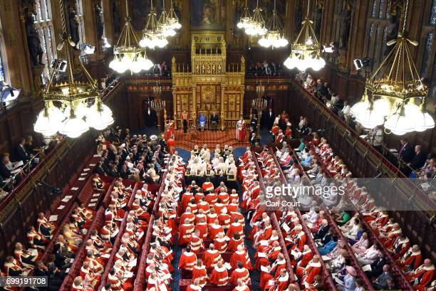 Queen Elizabeth II accompanied by Prince Charles Prince of Wales makes a speech at the State Opening Of Parliament in the House of Lords on June 21...