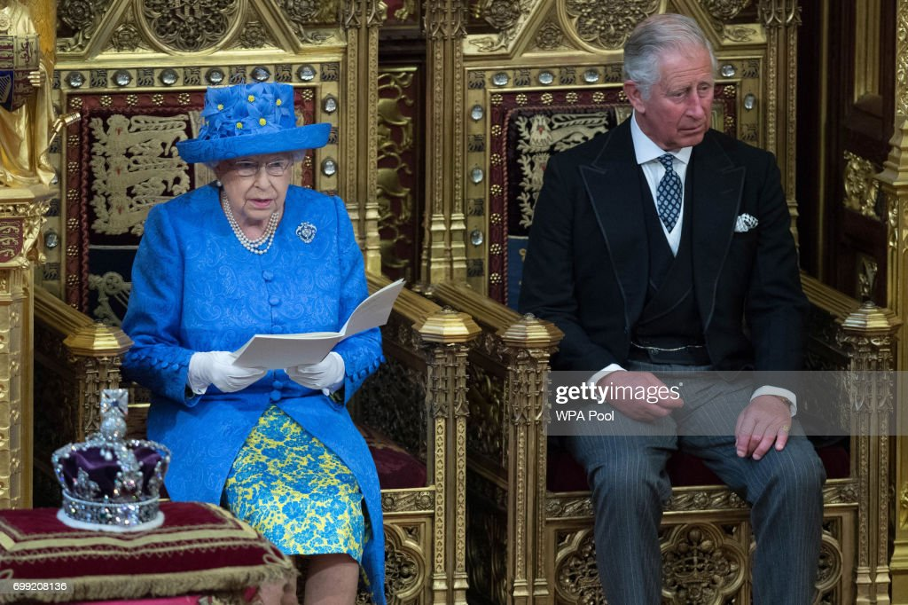 Queen Elizabeth II, accompanied by Prince Charles, Prince of Wales, makes a speech at the State Opening of Parliament in the House of Lords at the Palace of Westminster on June 21, 2017 in London, England. This year saw a scaled-back State opening of Parliament Ceremony with the Queen arriving by car rather than carriage and not wearing the Imperial State Crown or the Robes of State.