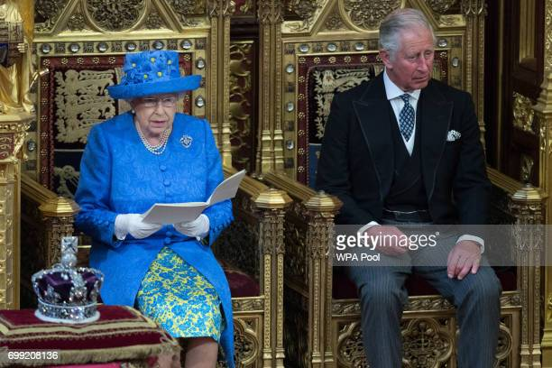 Queen Elizabeth II accompanied by Prince Charles Prince of Wales makes a speech at the State Opening of Parliament in the House of Lords at the...