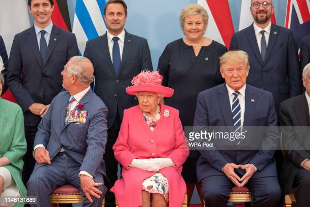 Queen Elizabeth II accompanied by Prince Charles Prince of Wales President of the United States Donald Trump pose for a formal photograph with...