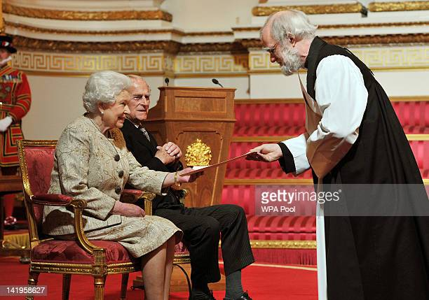 Queen Elizabeth II accompanied by Prince Philip Duke of Edinburgh receives a copy of the loyal address from the Archbishop of Canterbury Dr Rowan...