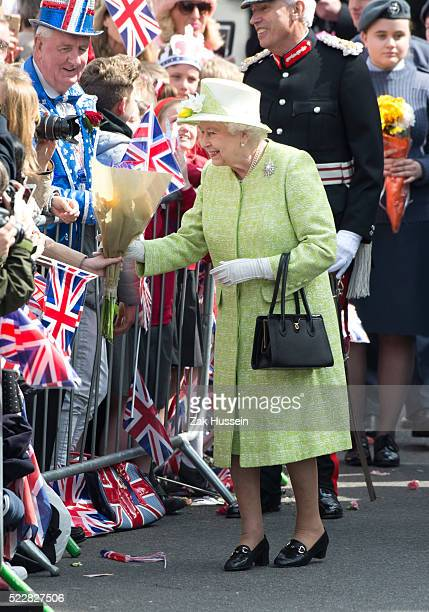Queen Elizabeth II accompanied by Prince Philip Duke of Edinburgh unveil a plaque marking The Queen's Walkway at the foot of Castle Hill during a...