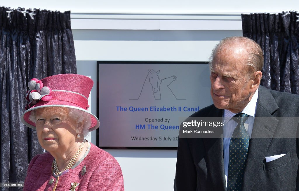Queen Elizabeth II accompanied by Prince Philip, Duke of Edinburgh unveils a plaque to commemorate the new section of the Queen Elizabeth II Canal at the Kelpies on July 5, 2017 in Falkirk, Scotland. Queen Elizabeth II and Prince Philip, Duke of Edinburgh visited the new section the Queen Elizabeth II Canal, built as part of the £43m Helix project which features the internationally-acclaimed, 30-metre-high Kelpies sculptures.