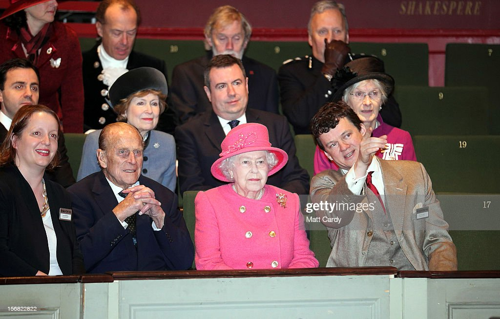 Queen Elizabeth II accompanied by Prince Philip, Duke of Edinburgh are shown around the recently refurbished Bristol Old Vic Theatre by artistic director Tom Morris (R) on a visit to Bristol as part of her Jubilee Tour on November 22, 2012 in Bristol, England.