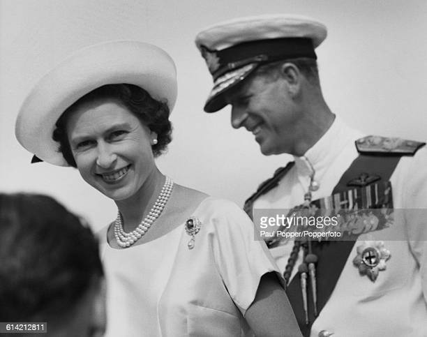 Queen Elizabeth II, accompanied by Prince Philip, Duke of Edinburgh, arrives in Bathurst , the capital city of Gambia during her tour of West Africa...