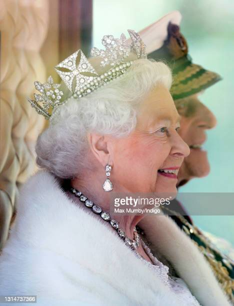 Queen Elizabeth II , accompanied by Prince Philip, Duke of Edinburgh, travels down The Mall in the Diamond Jubilee State Coach after attending the...
