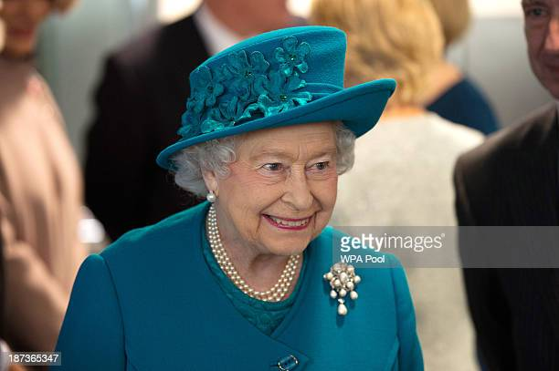 Queen Elizabeth II, accompanied by Prince Philip, Duke of Edinburgh, officially opens the headquarters of SSAFA on November 8, 2013 in London,...