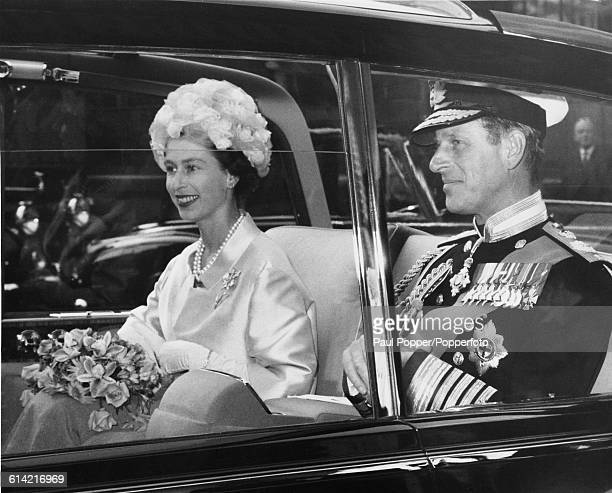 Queen Elizabeth II accompanied by Prince Philip Duke of Edinburgh leave the Guildhall in the City of London in a limousine after attending a 'welcome...