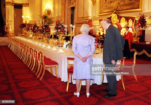 Queen Elizabeth II, accompanied by Sir Hugh Roberts, the Director of the Royal Collection, views the Summer Opening exhibition at Buckingham Palace...