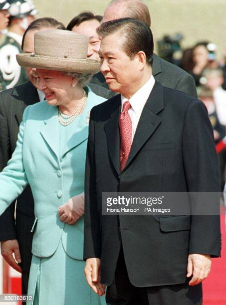 Queen Elizabeth II accompanied by South Korea's President Kim Daejung greets guests outside the Blue House presidential residence in the capital...
