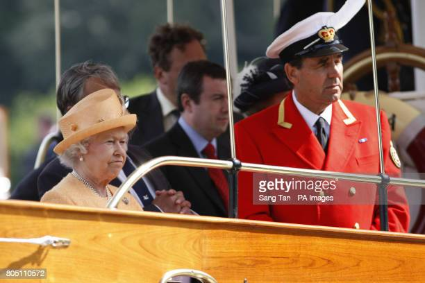 Queen Elizabeth II accompanied by Swan Marker David Barber watching the swan upping census from the steam launch 'Alaska' on the River Thames near...