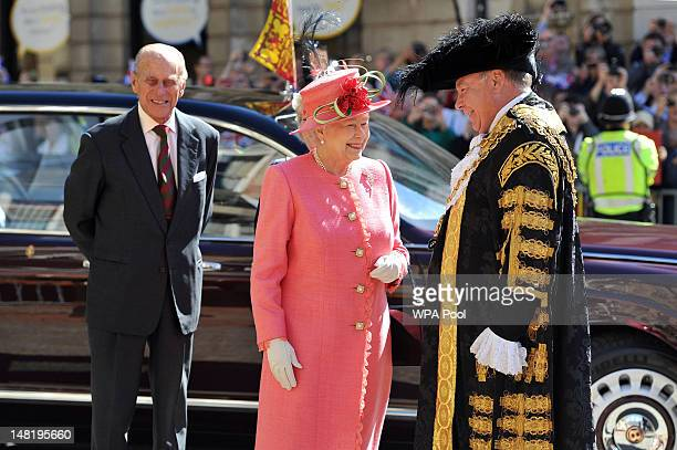 Queen Elizabeth II, accompanied by the Prince Phillip, Duke of Edinburgh, are greeted by the Lord Mayor of Birmingham Councillor John Lines as they...