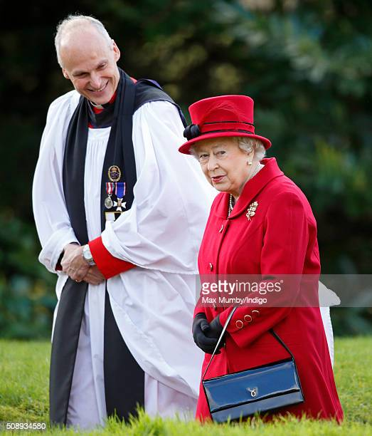 Queen Elizabeth II accompanied by the Reverend Jonathan Riviere departs after attending Sunday service at the Church of St Peter & St Paul, West...