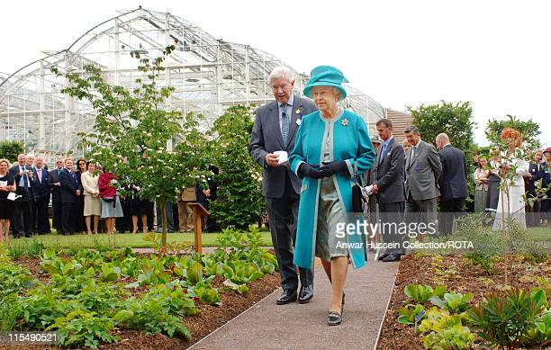 Queen Elizabeth II accompanied by the Society's President Peter Buckley visits the Royal Horticultural Society Garden at Wisley Surrey where she...
