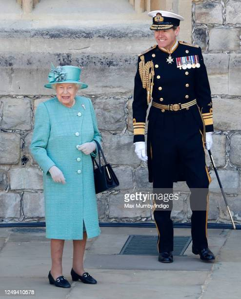 Queen Elizabeth II, accompanied by Vice Admiral Tony Johnstone-Burt , attends a military ceremony in the Quadrangle of Windsor Castle to mark her...