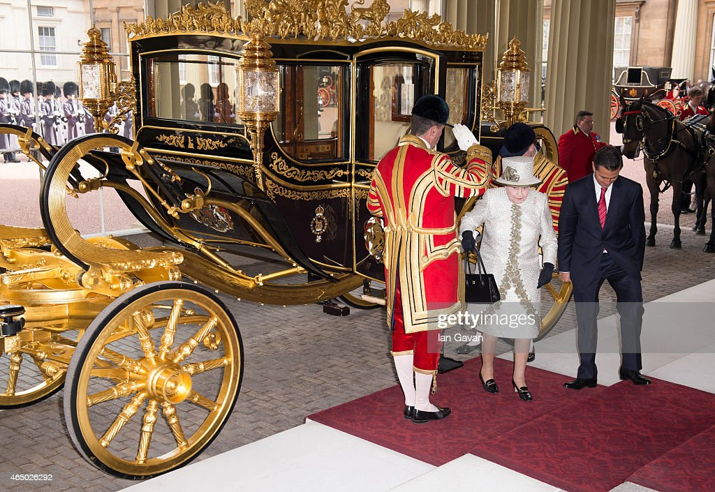 Queen Elizabeth II accompanies the President of the United Mexican States, Senor Enrique Pena Nieto to Buckingham Palace on March 3, 2015 in London, England. The President of Mexico, accompanied by Senora Angelica Rivera de Pena, are on a State Visit to the United Kingdom as the guests of Her Majesty The Queen from Tuesday 3rd March to Thursday 5th March.