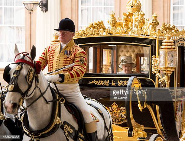 Queen Elizabeth II accompanies the President of the United Mexican States, Senor Enrique Pena Nieto to Buckingham Palace on March 3, 2015 in London,...