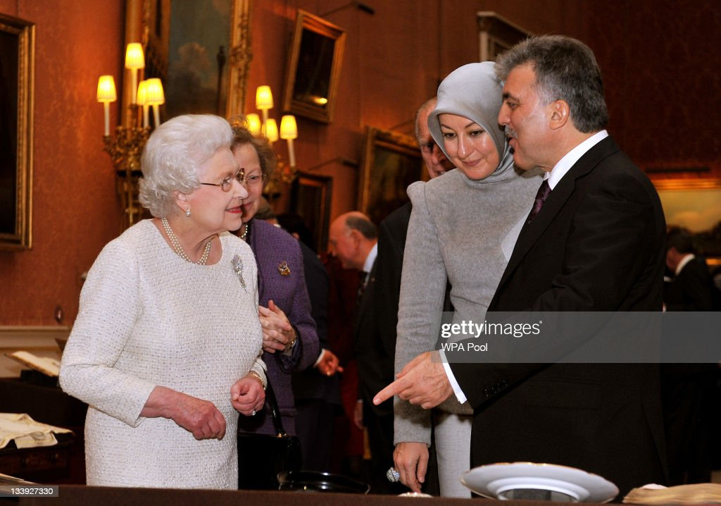 Queen Elizabeth II accompanies the President of Turkey Abdullah Gull and his wife Hayrunnisa, as they tour an exhibition of Turkish Artefacts from the Royal collection, in the Picture Gallery of Buckingham Place on November 22, 2011 in London, England. The President of Turkey is on a five day State visit to the UK.