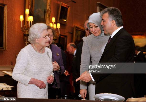 Queen Elizabeth II accompanies the President of Turkey Abdullah Gull and his wife Hayrunnisa as they tour an exhibition of Turkish Artefacts from the...
