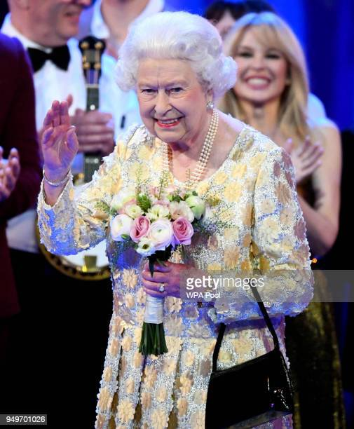 Queen Elizabeth II acknowledges the audience after a speech by Prince Charles Prince of Wales at the end of a starstudded concert to celebrate the...