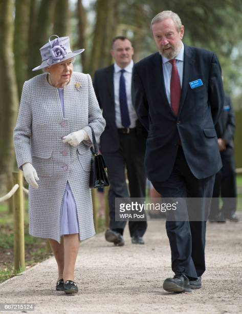 Queen Elizabeth II acompanied by Zoo Director Sir John Bedington arrives to open the new Centre for Elephant Care at ZSL Whipsnade Zoo on April 11...