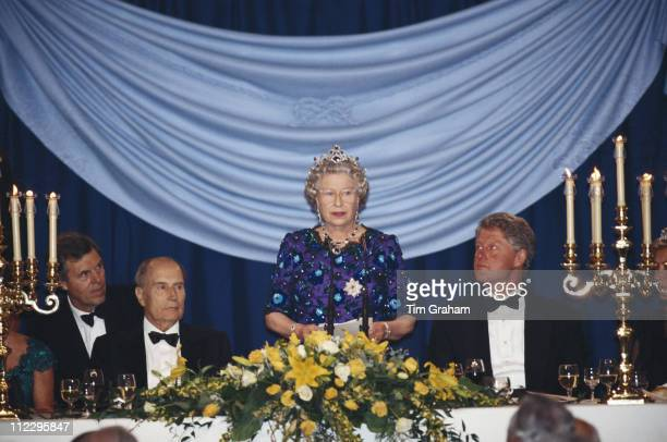 Queen Elizabeth II addresses a banquet also attended by President of France Francois Mitterrand and US President Bill Clinton at Portsmouth Guildhall...