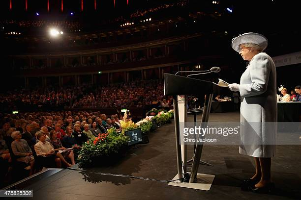 Queen Elizabeth II addresses the Centenary Annual Meeting of The National Federation Of Women's Institute at Royal Albert Hall at the Royal Albert...