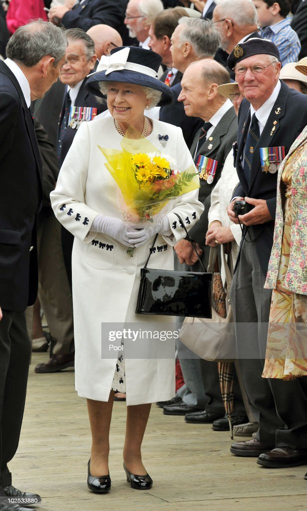 Queen Elizabeth II after being given flowers by a Navy veteran on June 29, 2010 in Halifax, Canada. The Queen and Duke of Edinburgh are on an eight day tour of Canada starting in Halifax and finishing in Toronto. The trip is to celebrate the centenary of the Canadian Navy and to mark Canada Day. The royal couple will make their way to New York where the Queen will address the UN and visit Ground Zero on July 6.