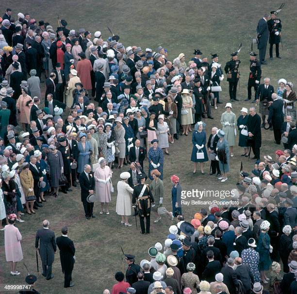 Queen Elizabeth II amidst the crowd at a garden party at the Palace of Holyrood in Edinburgh on 3rd July 1962
