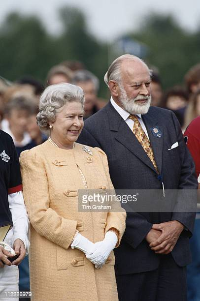 Queen Elizabeth II and Alfred Dunhill attending a polo match held at Home Park in Windsor Berkshire England Great Britain 4 June 1995 The Queen is...
