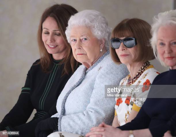 Queen Elizabeth II and Anna Wintour attend the Richard Quinn show during London Fashion Week February 2018 at BFC Show Space on February 20 2018 in...