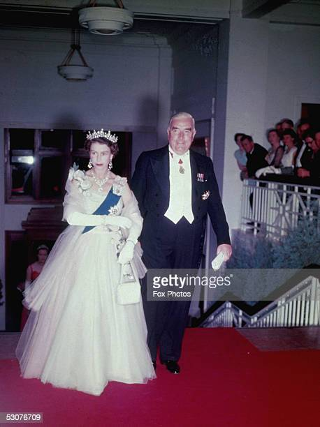Queen Elizabeth II and Australian prime minister Robert Gordon Menzies arrive at a state banquet in Canberra during the Queen's tour of Australia 1954