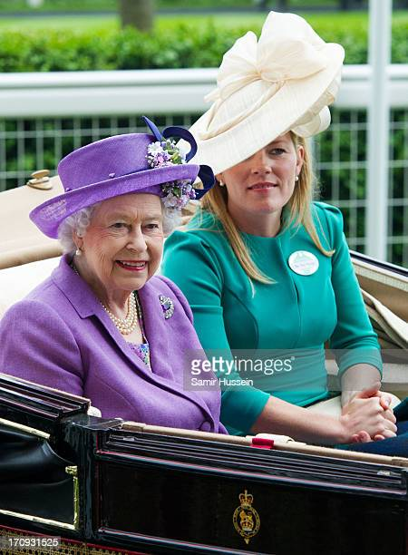 Queen Elizabeth II and Autumn Phillips arrive by carriage on Ladies Day on day 3 of Royal Ascot at Ascot Racecourse on June 20 2013 in Ascot England