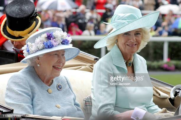 Queen Elizabeth II and Camilla Duchess of Cornwall arrive in a horse carriage on day two of Royal Ascot at Ascot Racecourse on June 19 2019 in Ascot...