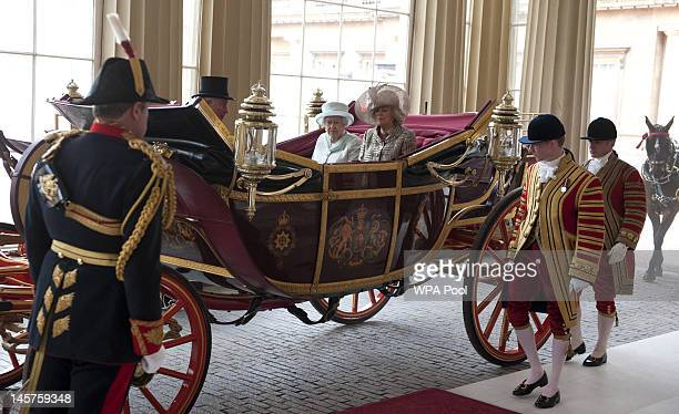 Queen Elizabeth II and Camilla, Duchess of Cornwall arrive in the 1902 State Landau coach at Buckingham Palace at the end of a carriage procession...