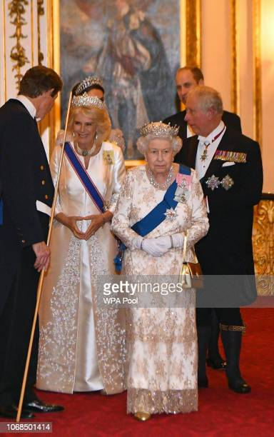 Queen Elizabeth II and Camilla Duchess of Cornwall greet guests at an evening reception for members of the Diplomatic Corps at Buckingham Palace on...